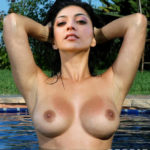 Kajal Aggarwal sexy wet boobs in swimming pool without costumes